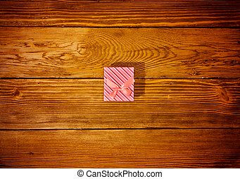 Wrapped Gift on Wooden Background