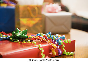 Wrapped gifts. - Presents wrapped and decorated with bows on...