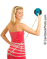 Wrapped girl measuring her waist