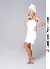 Wrapped in towel - Beautiful woman standing isolated wrapped...