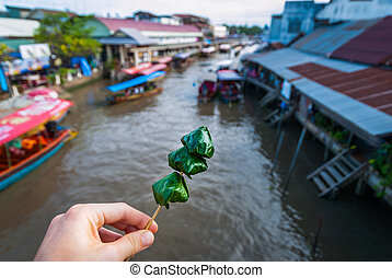 Wrapped Miang Kham, over the river canal - Wrapped Ming kham...