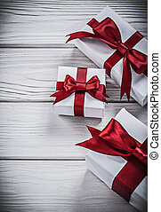 Wrapped present boxes on wooden board holidays concept.