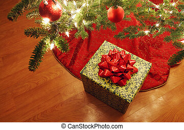 Wrapped present under a Christmas tree - Presents under a...