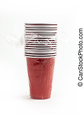Wrapped Red plastic cups isolated over white background