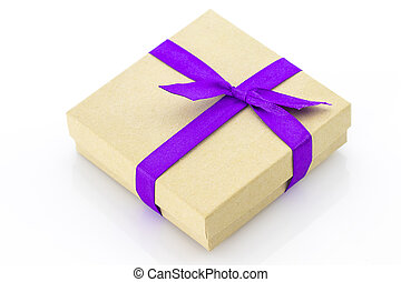 Wrapped vintage gift box with purple ribbon  isolated