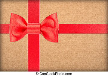 Wrapped vintage gift with red bow