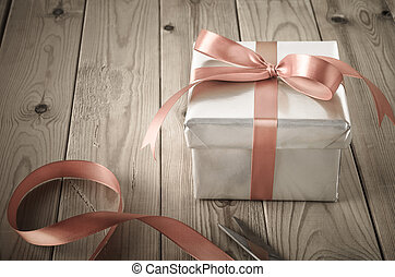 Wrapping of Gift Box with Vintage Effect - A gift box with...