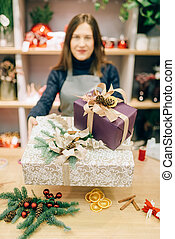 Wrapping service seller with festive gift boxes