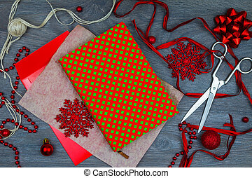Wrapping up christmas gift. - Notebook, string, scisors, red...
