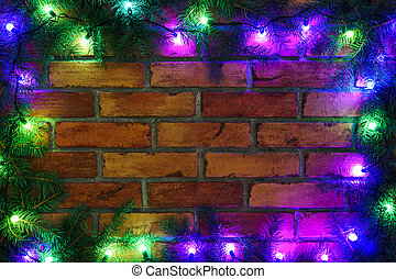 Wreath and garlands of colored light bulbs.Christmas background with lights and free text space. Christmas lights border. Glowing colorful Christmas lights on a brick wall background. New Year.