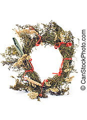 Wreath of dry herbs isolated on white