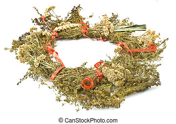 Wreath of dry herbs isolated on white background