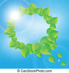 wreath of green leaves on a sunny sky background