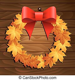 Wreath of yellow leaves on wooden background