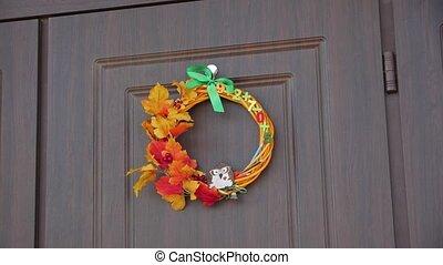 Wreath on the door autumn decoration slow motion camera movement
