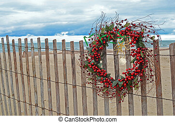 wreath with starfish on fence