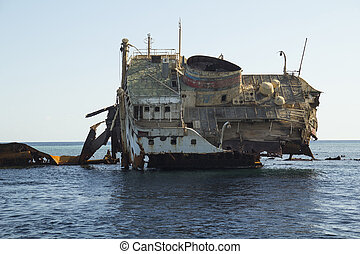 Wreck in the Red Sea - body of the dead ship stranded on a...