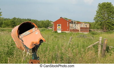 Wrecked mailbox & abandoned house.