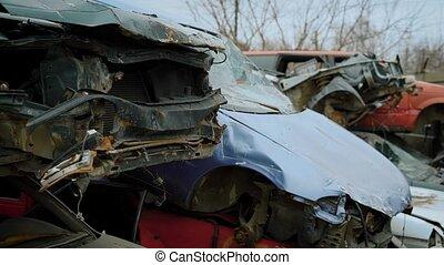 Wrecked old cars in stacks - Junkyard of plenty broken rusty...