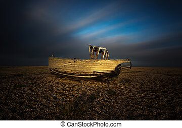 Wrecked ship in sunset at Dungeness