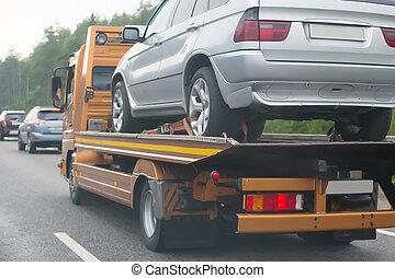 wrecker transports broken car - help on road transports...