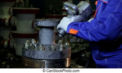 Wrench Tightening Bolt into steel spurt framework - Wrench...