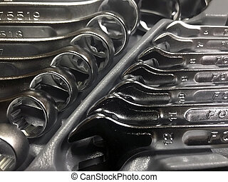 Wrench tool metal isolated spanner equipment steel industry construction work object. Workshop repair service iron mechanic hand key maintenance engineering instrument macro photography