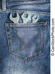 Wrenches in blue jeans pocket
