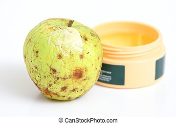 Wrinkle care - Wrinkled apple with skin cream applied