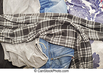 Wrinkled clothes lying on sofa