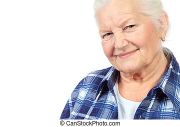 wrinkled face - Happy senior woman smiling at the camera. ...