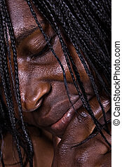 wrinkled - low-key African woman portrait, special light was...