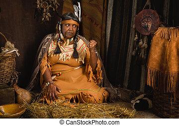 Wrinkled native woman - Weathered mature tribal female...
