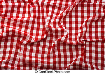 Wrinkled tablecloth red tartan in cage texture wallpaper. Unique perspectives top view.