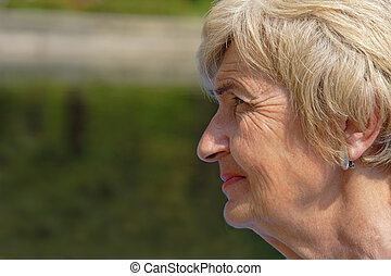 Wrinkled woman profile - Wrinkled profile of a senior woman...