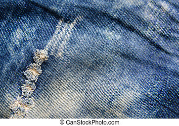 Wrinkles blue jeans texture. Jeans background.