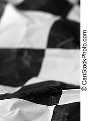 wrinlked checkered race flag, shallow depth of view