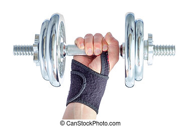 Wrist damage rehabilitation. Hand in brace holding metal dumbbell