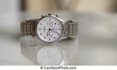 Wrist watch on table timelapse