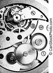 wrist watch -  disassembled wrist watch lies on  table