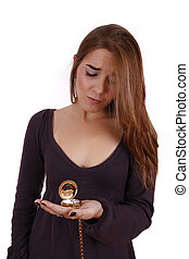 Wrist watch - Woman looking at a wrist watch with a worried...