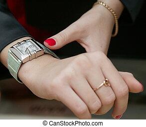 Wrist-watch - Female hands and  wrist-watch