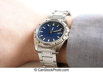 Wristwatch  - Closeup of businessman's hand with wristwatch