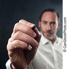write on virtual flipchart - Close-up of mature business man...