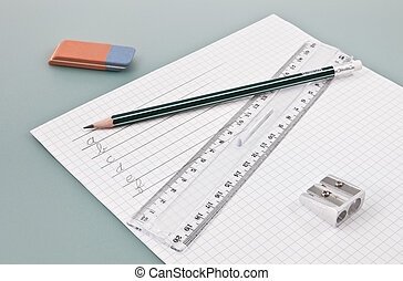 Write training supplies on a white paper with some handwrited single letters