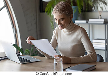 Short-haired confident woman writer accomplish literary composition read check text hard copy feels proud. Successful business woman ceo prepared business strategy development plan, good news concept