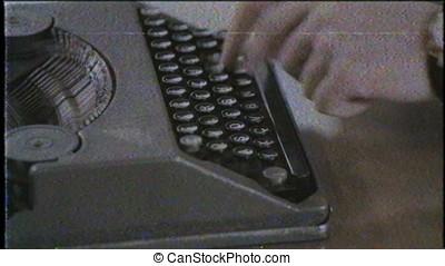 Writer writing with retro typewriter, close up, old film