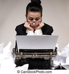 Writers Block - Retro business woman with vintage typewriter