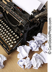 Retro typewriter with paper scattered all around - conceptual image for creative block