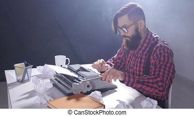 Writer's day concept. Young male writer in a dark room...